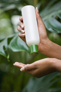 Mixed race woman pouring lotion into hand